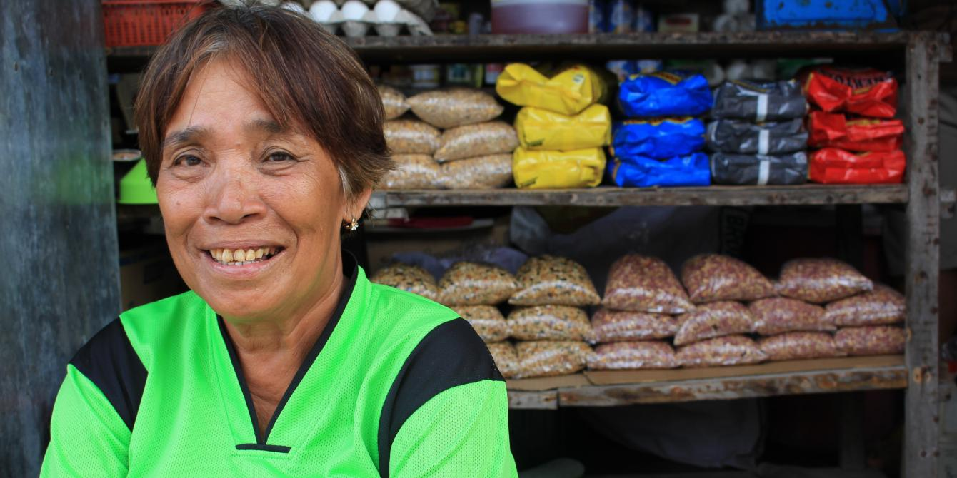 Herminia Caraga from Dolores, Eastern Samar, poses in front of the store owned by the women's association of which she is an active member (Photo: Genevive Estacaan/Oxfam)