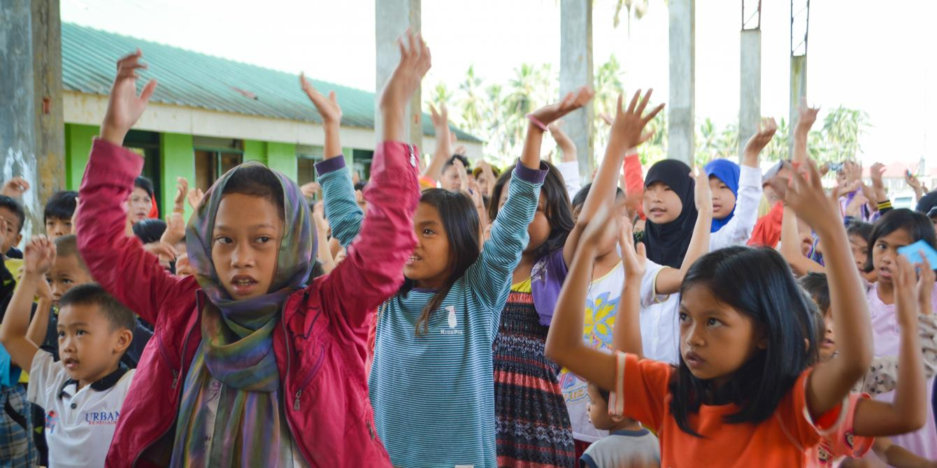 Children participate in a psychosocial support session in Saguairan, Lanao del Sur