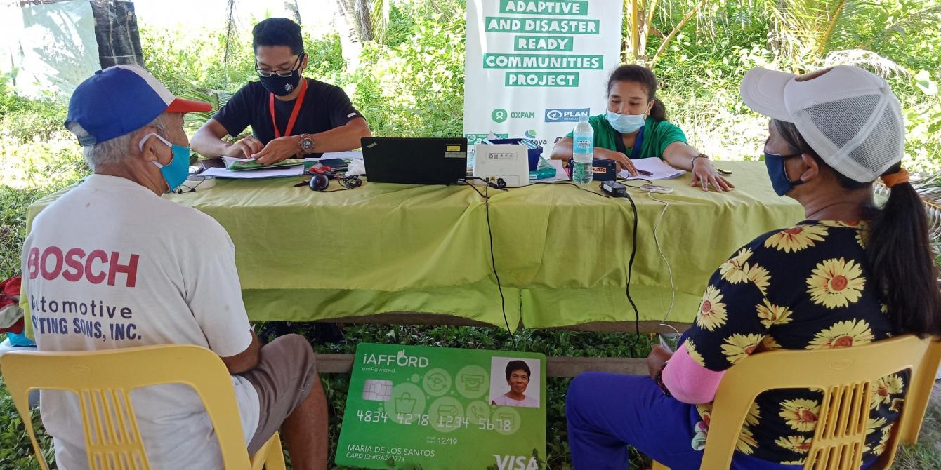 Distribution of iAFFORD Cards to project participants in Barangay Burak, one of the priority areas of the B-READY Project. (Photo: PDRRN)
