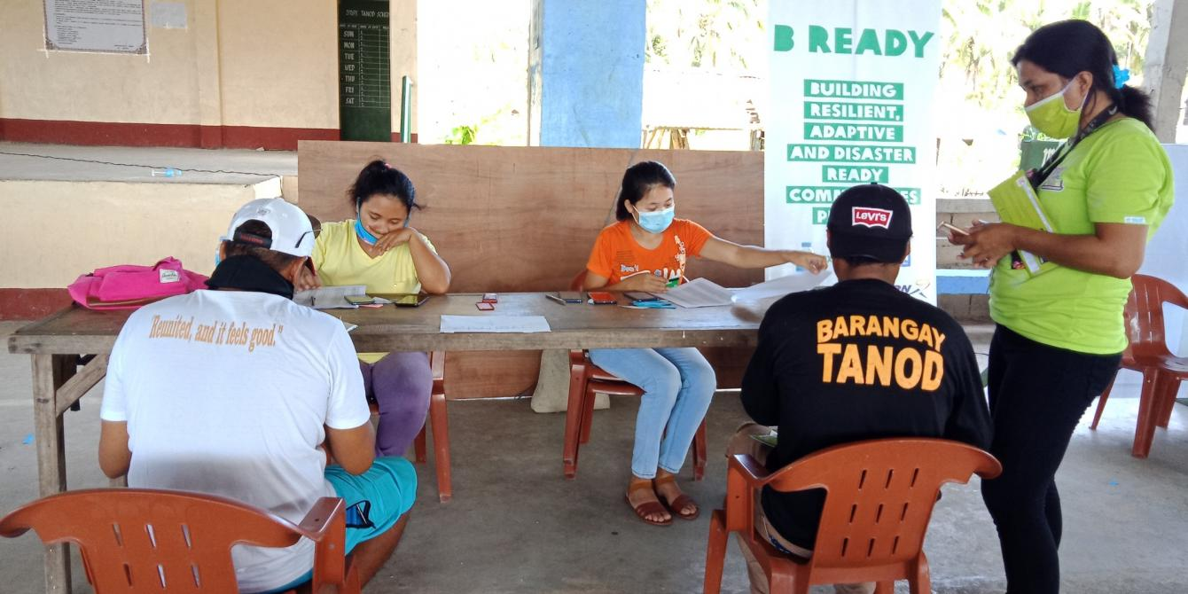 Distribution of iAFFORD Cards to project participants in Barangay Matarinao, one of the priority areas of the B-READY Project. (Photo: PDRRN)