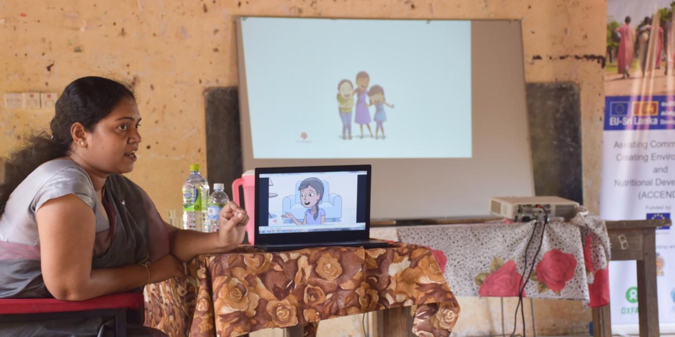 Sri Lankan teacher uses digital visual aids to carry out a awareness session on menstrual health and hygiene