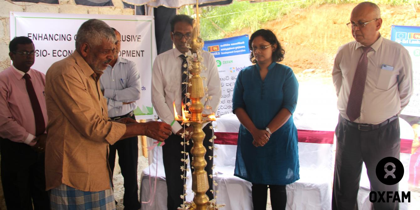 Lighting the traditional oil lamp at the foundation-laying ceremony