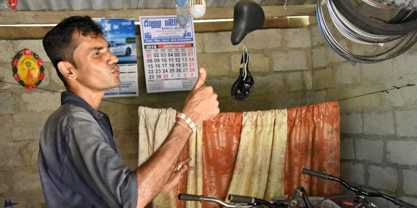 Sri Lankan mechanic thumbs up