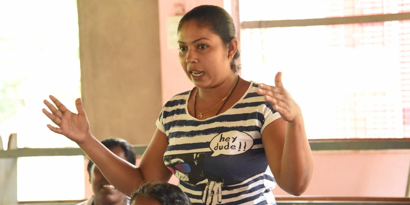 Woman speaking at the CFW assessment meeting