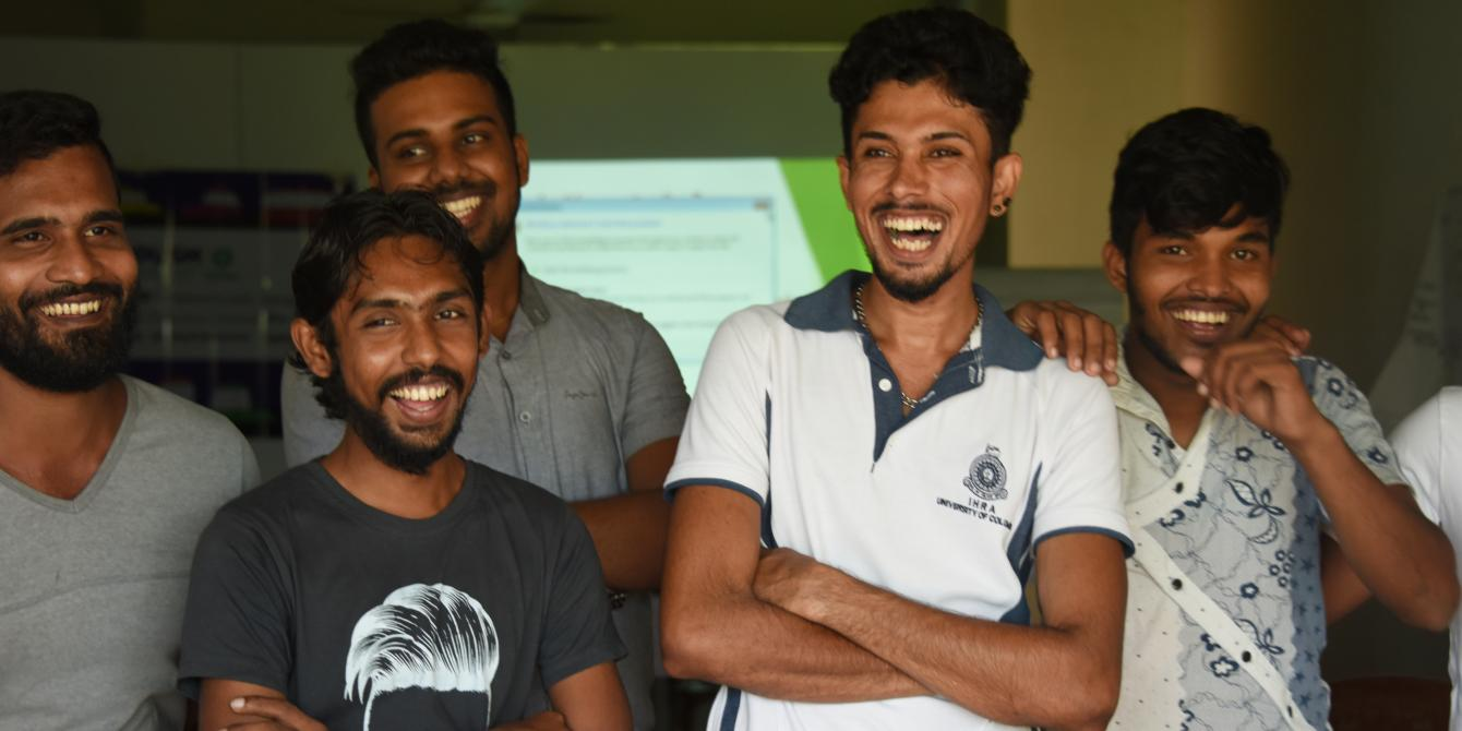 Young, smiling Sri Lankan men