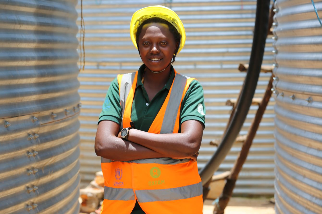 Ndayikunda Felista is an incentive construction worker trained by Oxfam in the Nduta refugee camp in Kigoma, Tanzania. Photo: Bill Marwa/Oxfam.
