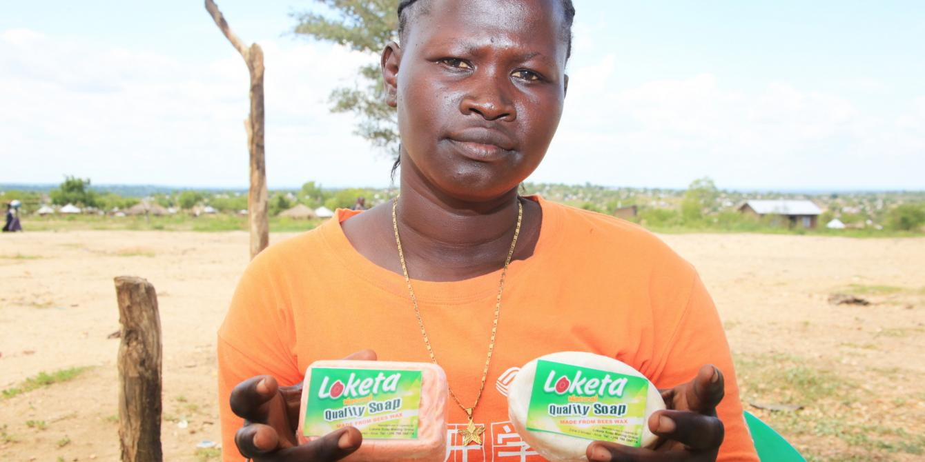 South Sudanese Refugee Farida Hatayi, 28 year old mother of 4, displays bathing soap made her Loketa Soap Making Gro