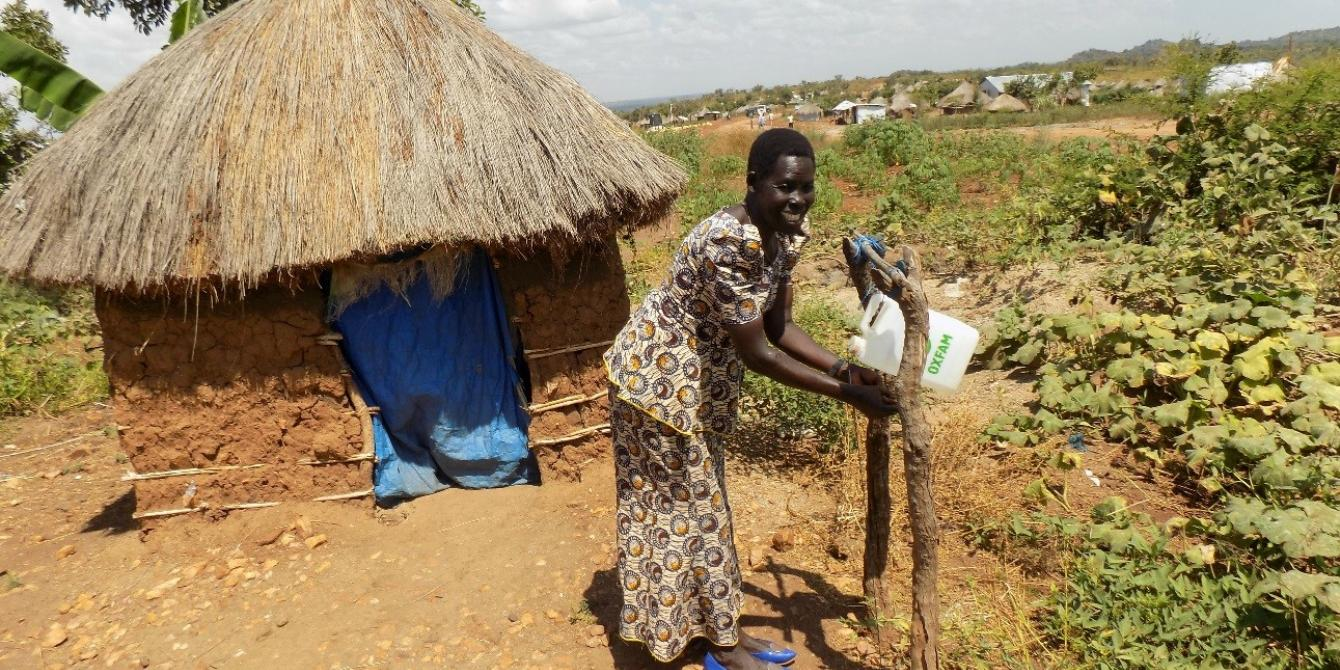 The use of Tippy Taps has been adopted in Rhinocamp settlement as a proper hygiene practice. photo credit: Oxfam