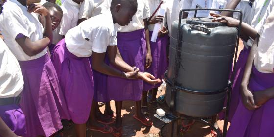 Proper hand washing as demonstrated by students of Illi Primary School, Omugo refugee settlement. Photo: Oxfam