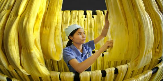 Factory worker makes noodles. Credit: Oxfam Vietnam