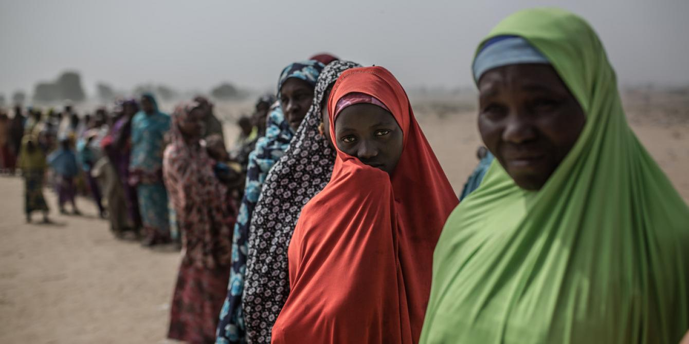 A group of women at the entrance to the displaced people's camp of Muna Garage in Nigeria.