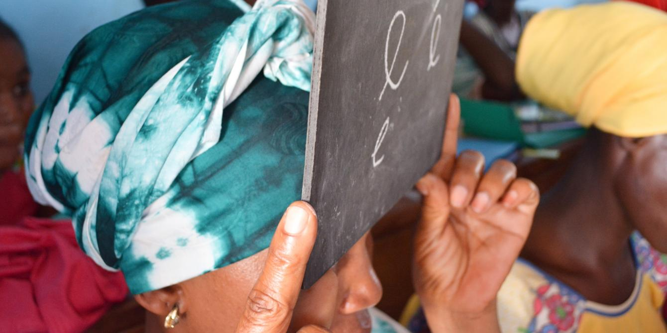 """Survivors of gender-based and other types of violence learn how to write the letter """"e"""" during a literacy lessons. Credit: Aurélie Godet / Oxfam"""